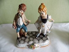 Capodimonte - boy and girl greeting each other