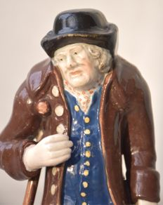 "A Staffordshire Pearlware figure depicting ""Old Age"", circa 1790-1820"