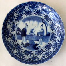 Plate with a garden scene - China - late 17th century