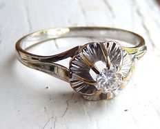 Antique solitaire engagement ring in 18 kt gold with 0.25 ct diamond