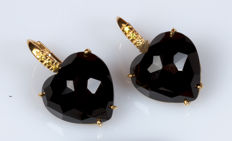 Yellow gold earrings with black heart-shaped onyx and diamonds