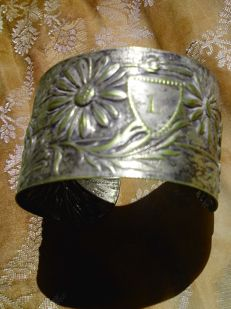 Very old antique bracelet in silver, with gold decorations