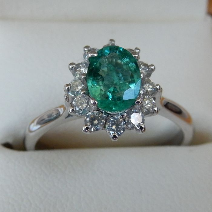 18 carat White Gold Modern Emerald and Diamond cluster ring, Insurance valuation £2,000