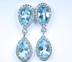 18 kt. Exclusive earrings in white gold with 80 GH-SI Diamonds and natural Blue Topazes in the shape of a water droplet.  Length: 24 mm.  No reserve price.