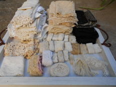 A large lot of antique laces and fabrics
