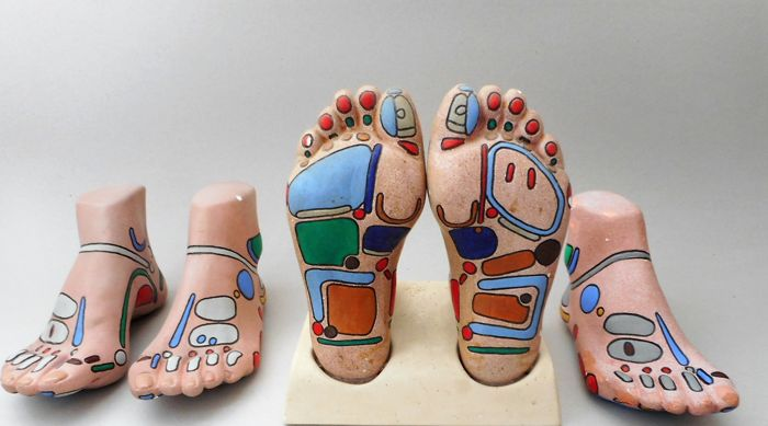Two pairs of foot models for a reflexology practice