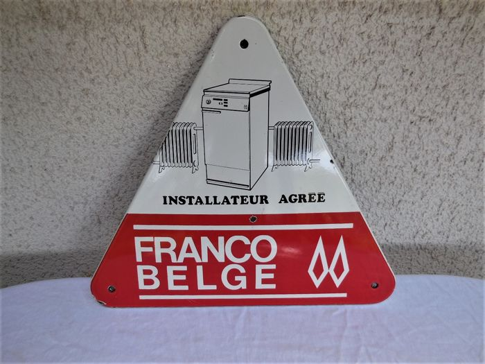 Old large triangular shaped enamel sign with washing machine, radiator and lettering