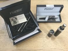 Offered are 4 Luxurious Charles dickens pens spread over 3 sets.