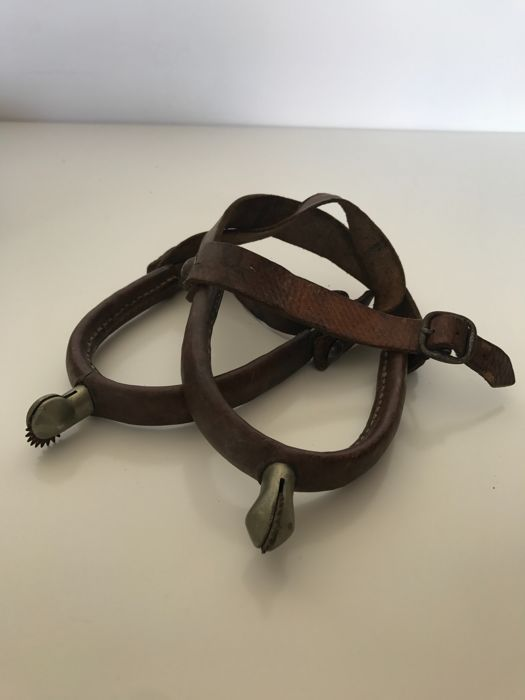 Old pair of spurs wrapped in leather of the 1960s France