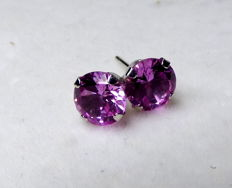 14 kt earrings with 2 ct pink sapphire, diameter: approx. 0.7 cm.