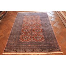 Magnificent hand-knotted Oriental carpet Bukhara Jomut. 200 x 130 cm. Made in Pakistan, mid of the 20th century.