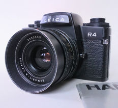 Leica R4 + Leitz Elmarit-R 35 mm f/2.8 lens with rear cap, manual and strap