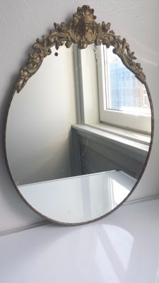 Oval vanity mirror with brass machined edge
