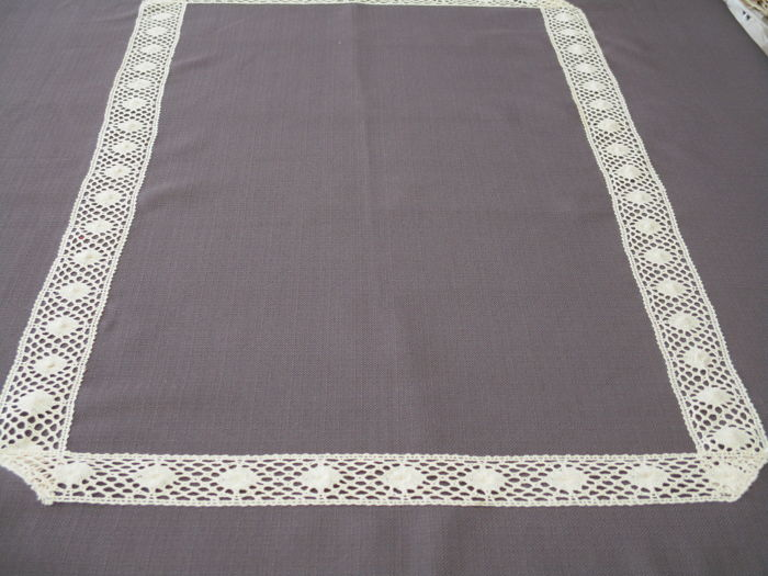 Tablecloth of Eggplant-grey toile, garnished with old lace.