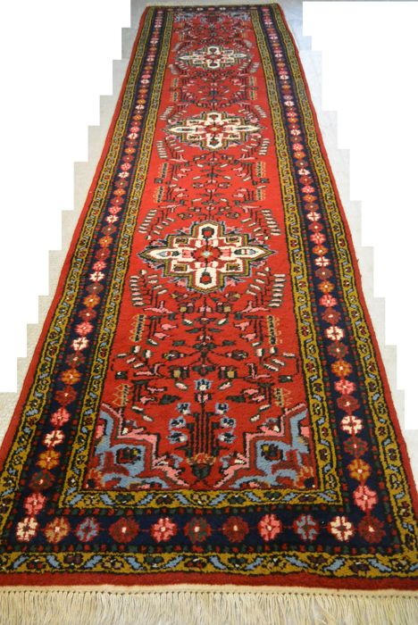 A beautiful handwoven Persian carpet 337 x 83 cm. End of the 20th century