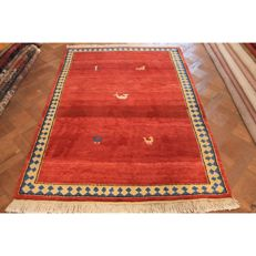 Handwoven carpet, Gabbeh, made by nomads, wool on wool, made in India, 200 × 140 cm