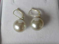 14 kt gold dangle earrings with pearls