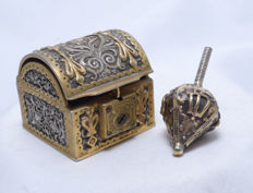 A bronze and silver spinning top and treasure box - England - circa 1920