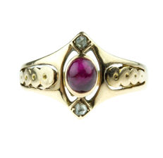 14 kt gold Art Nouveau ring set with a cabochon cut ruby and rose cut diamonds, ring size 14.5