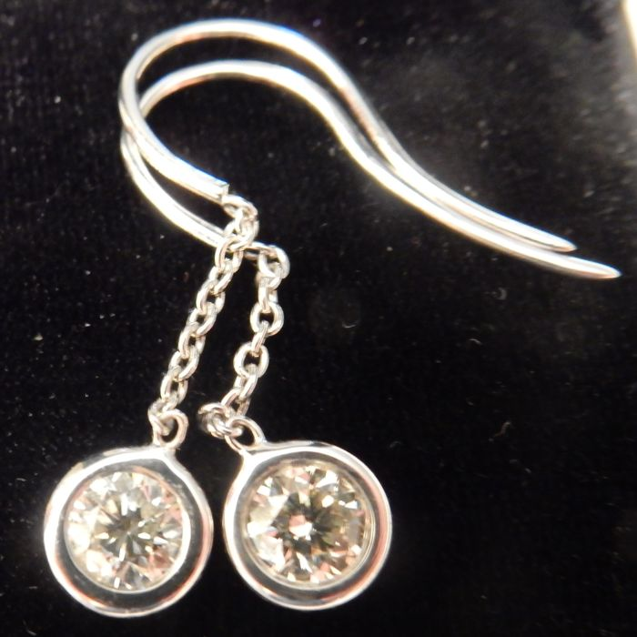 Beautiful 14 Carat White Gold drop earrings set with a single Diamond; total diamond content 0.95 carat