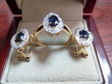 Set with 18 kt gold cocktail ring and earrings with central sapphires