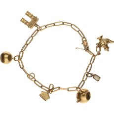 14 kt Yellow gold close for ever bracelet with 6 charms in the shape of a ball, house, kettle, teapot, tooth, Arc de Triomphe.