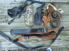 Collection of gun holsters, shoulder holsters and belts, several countries