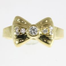 Diamond gold bow shaped ring