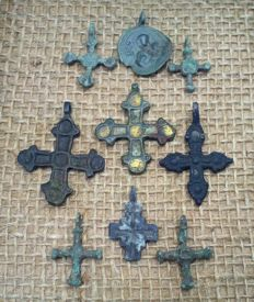 Early medieval bronze crosses, IX-XII century, in the frame for the exposure (9) 24x13 mm - 40x32 mm
