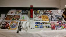 Complete Nintendo WIi Red inc. 2 controllers and 20 games