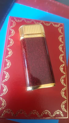 Oval Cartier lighter in maroon lacquer, gold plated, after year 2000