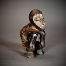 Small kneeling African Iginga LEGA Figure. Democratic Republic of the Congo.