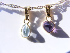 Pendants in 18 kt yellow gold, with aquamarine and amethyst.