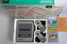 Boxed Super Nintendo console (Japanese import) with 2 controllers  and 3 games: Super Mario Collection, Bomberman B-Daman and Dragon Ball Z Super Butouden 2