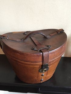 a leather storage case for a top hat, early 20th century