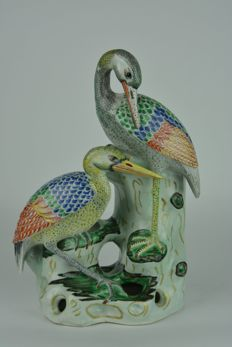 A colourful group of two porcelain cranes – China – late 20th century