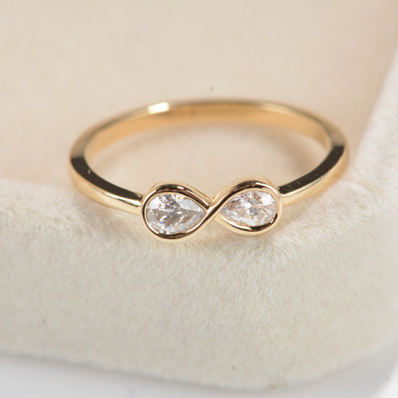 18 kt rose gold ring with infinity