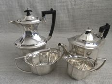 Ornate vintage four piece silver plated tea and coffee set . HARRISON FISHER &CO ENGLAND . 1900/1925