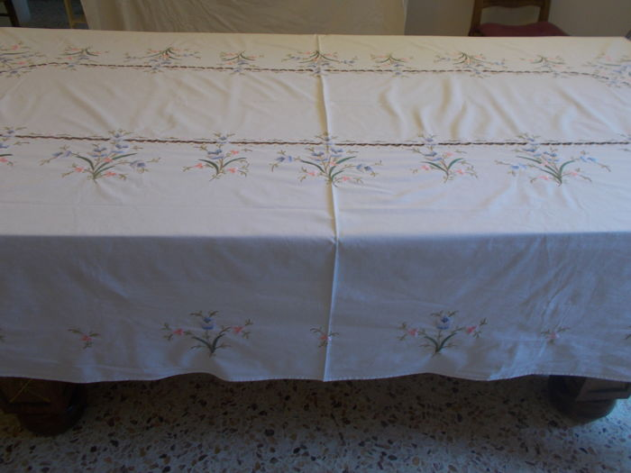 A large antique hand made embroidered tablecloth.