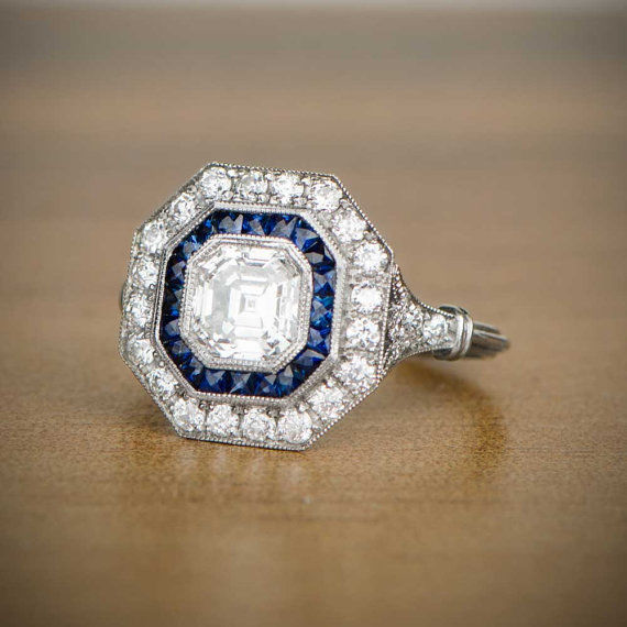 Asscher cut diamond ring set in 18/750, diamond and sapphire mounting 1.00 ct