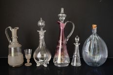 Glass decanters and an old bottle with cork, late 19th and early 20th century