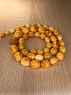 Natural Baltic Amber vintage necklace of olive shaped marble beads. 33.3 grams