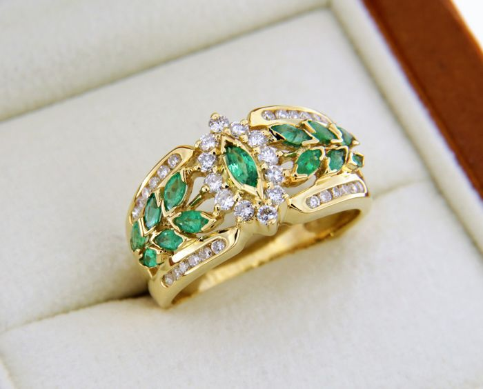 Gold ring with 12 Emeralds in the centre and Diamond entourage.