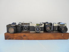 A lot of five single-lens reflex cameras, a Fed 4, a Petri MF 1, a Petri 7S II, a Zenit 11 and a Zenit E various years of production