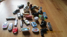 29 figural lighters - metal / plastic - 20th century