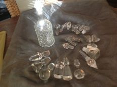 22 Crystal and glass bottle stoppers and 1 bottle with stopper
