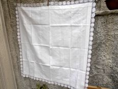 Hand embroidered tablecloth with filet crochet