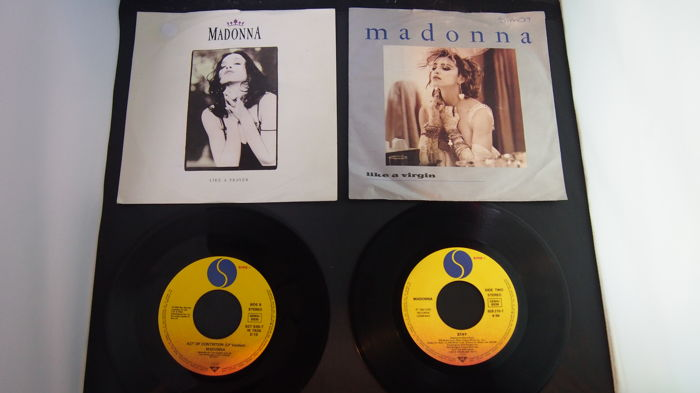 Lot of Madonna albums and single records including the limited poster inside the first album