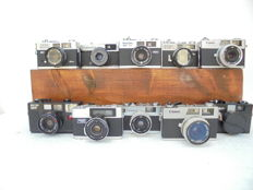 A lot of 10 cameras,  2x rangefinder camera Canon Canonet 28, Yashica Electro 35 MC, Ricoh 35 EF, 35 ZF, 500 G and a 35 ST, Olympus trip 35, Minolta Himatic G2 and finally a Revue 7000 EL