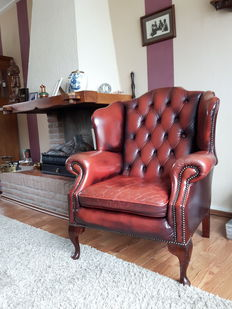 Chesterfield style red leather wing chair, England, late 20th century